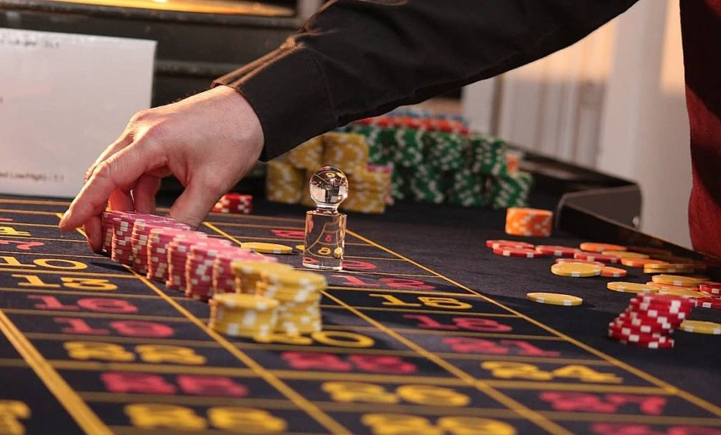 Man in black shirt is playing poker
