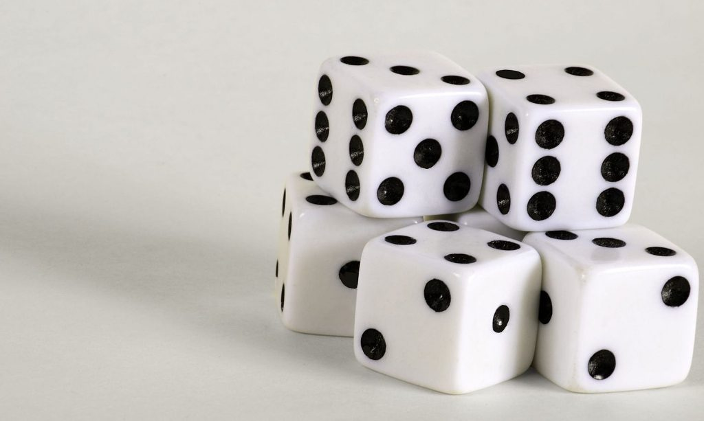 White dices on the white table